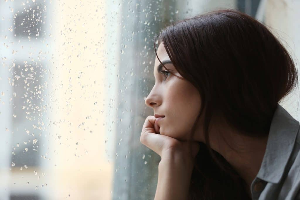 an image of a lady suffering with depression
